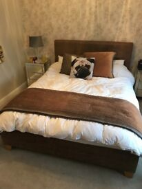 King size brown leather bed frame.