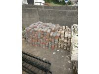 Bricks, decorative wall blocks and iron railings