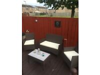 Rattan 2 seat sofa, 2 chairs and glass top coffee table