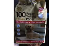 Opened bag of puppy pads (around 70 pads)