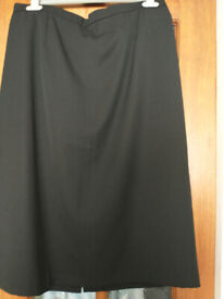 Ladies smart skirt. Black. Size 18. Length 28inches, Waist 34inches. New cond.