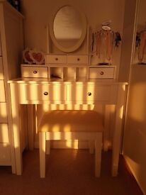 As new assembled white dressing table with mirror and stool