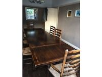 Solid Oak hand made extending refectory table and chairs.
