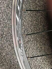 Shimano tiagra rear wheel and hub.