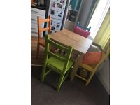 Table and coloured chairs