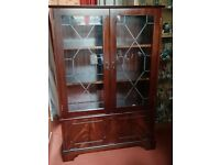 Lovely solid dark wood display cabinet with drop down cupboard