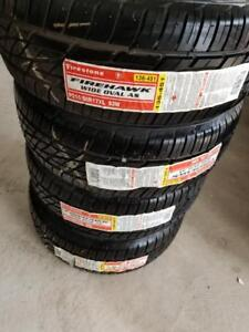 BRAND NEW WITH LABELS ULTRA HIGH PERFORMANCE ' W ' RATED 215 / 50 / 17 ALL SEASON TIRE SET OF FOUR.