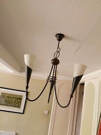 Antiqued metal light fittings for living/dining room.