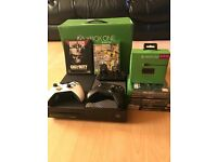 1TB Xbox One console boxed, 2 controllers, 10 games, play and charge kit