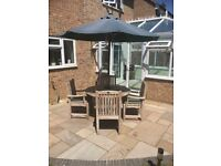 Teak circular patio / garden table and four chairs