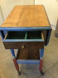 Oak drop leaf table on castors with drawer