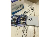PS4 Slim Glacier White Boxed 500GB + Games