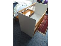 Drop side cot bed with mattress
