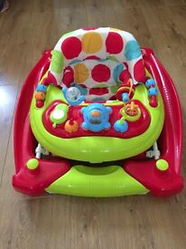 Walker/rocker for a baby in very good condition.