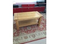 Coffee table, sturdy light oak coffee table. Good condition. 100cm x 50cm x50cm with lower shelf.