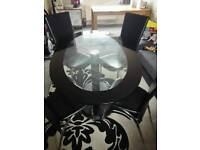 Black glass table & 4 leather chairs