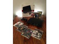 Playstation 3 Slim 160gb boxed + 8 games