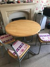 Round table with 4chairs and cushions