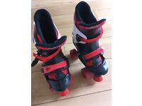 Osprey child's quad roller skates adjustable sizes 13-3 (32-36)