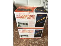 Brand new set of 7 solar fence lights