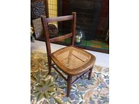 Antique child's cane seat chair