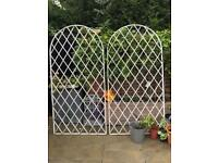 Two metal garden frames/ trellis with posts