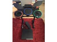 PS3 slim with guitar hero drums game and pad