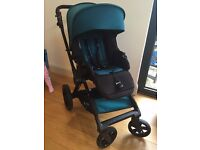 Jane Muum pushchair with Jane Matrix 2 lie flat car seat and rain cover.