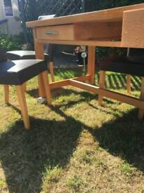 Solid wooden table and chairs