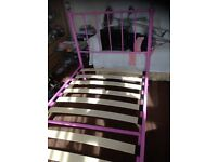 Girls lovely pink single bed with crystal baubles on the corner posts