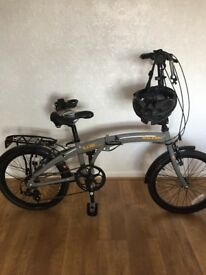 Bicycle, fold-up, Raleigh EV02. Ridden twice, cost £250, selling £150, + helmet + lock.