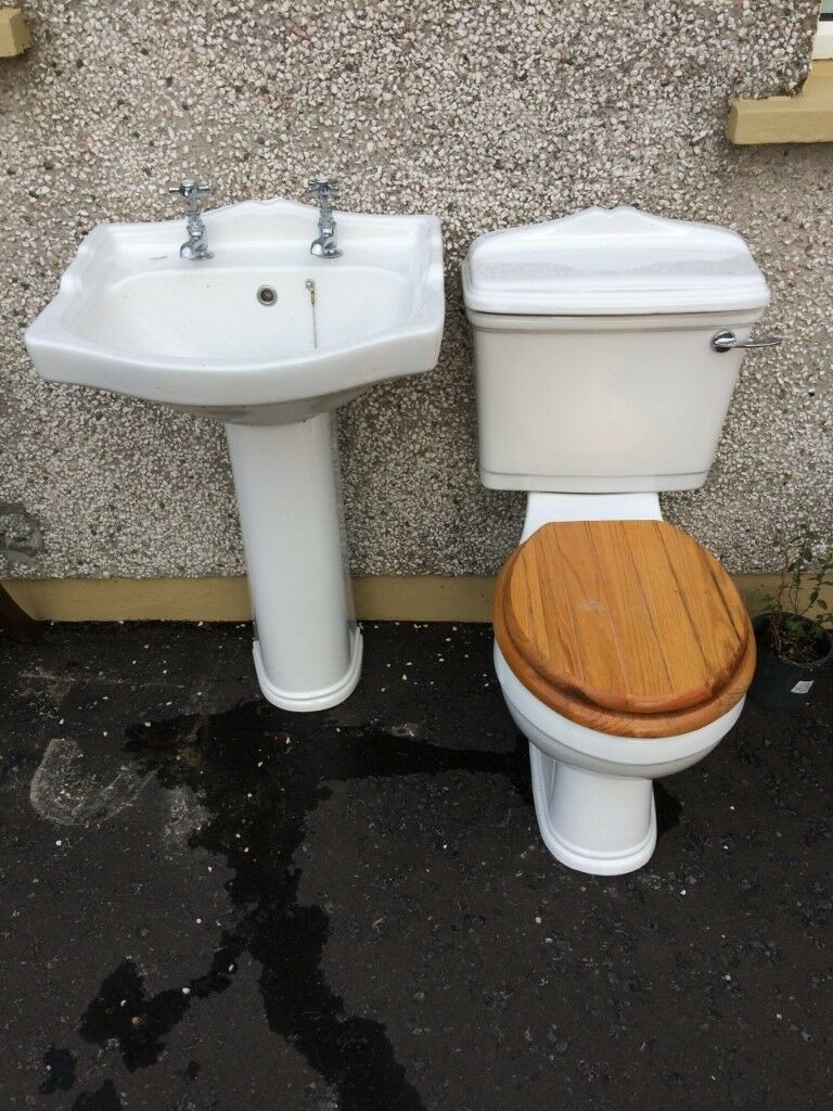 Modern close coupling toilet and matching sink and pedestal in ...