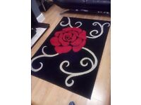 Large Black white and red rug for sale