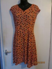 PEACHY COLOUR DRESS WITH CATS PATTERN NO SIZE OR MAKE ITS ABOUT A 10
