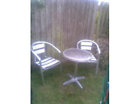 garden coffee table and two chairs