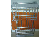 Folding electric heated clothes airer with wings. new.
