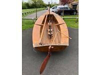 Vintage solo sailing dinghy and trailer