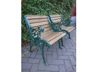 A MATCHING PAIR OF SOLID CAST IRON CHAIRS IN METALLIC GREEN FOR GARDEN, PATIO OR CONSERVATORY