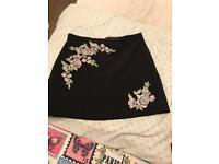 Ladies black mini skirt with flowers
