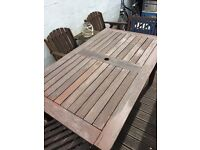 Wooden garden table and four chairs £65 free delivery.