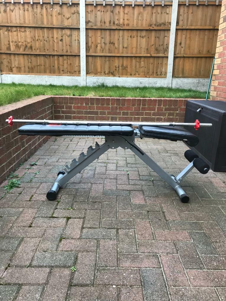 Gym bench, barbell and dumbbells