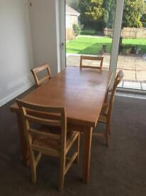 Extending dining table with eight chairs