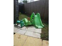 Childrens slide, seesaw and scuttlebug