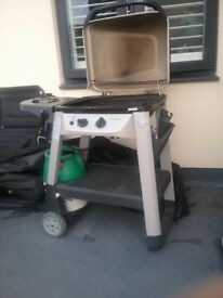 Outback Exel Gas BBQ on wheeled trolley with very useful side burner. Excellent condition.
