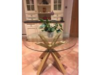 Next Glass Dining Table with solid oak legs..