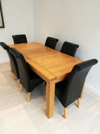Solid Oak table and six faux black leather chairs