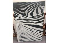 Canvas print on wooden frame of zebra