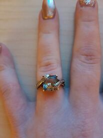 Green amethyst gold stamped engagement ring with small diamonds in twist edging around a size k