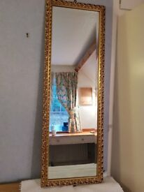 Mirror, large, bevelled with decorative gold frame