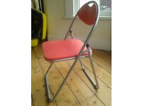 Red chair. A couple of scratches to red padding but very functional and clean chair.